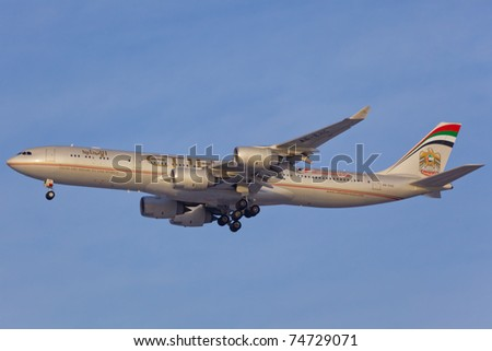 NEW YORK - MARCH 10: Airbus A340-600 of Etihad approaching JFK in New York, USA on March 10, 2011, Etihad is one of the most expensive and rated top5 best airlines in the world - stock photo