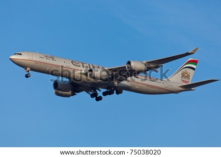 NEW YORK - MARCH 10: Airbus A340-600 of Etihad approaching JFK in New York, USA on March 10, 2011. Etihad is one of the most expensive and rated top5 best airlines in the world - stock photo