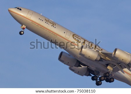 NEW YORK - MARCH 10: Airbus A340-600 of Etihad approaching JFK in New York, USA on March 10, 2011. Etihad is one of the most expensive and rated top 5 best airlines in the world - stock photo