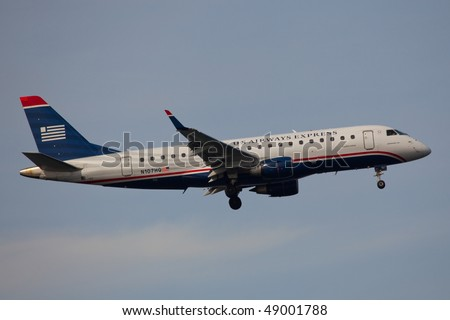 NEW YORK - MARCH 1: Airbus A320 US Airways arriving on JFK Airport Runway 4R on March 1, 2010 in New York - stock photo