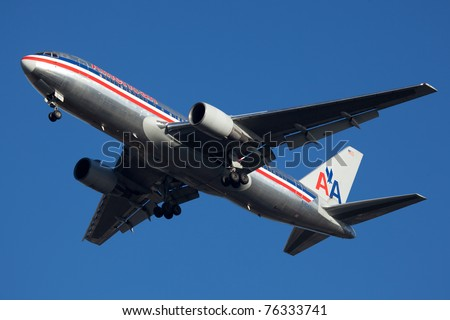 NEW YORK - MARCH 8: Boeing 767 American Airline approaching JFK in New York, USA on March 8, 2011. Boeing 767 have range 5,200 to 6,590 nautical miles, can carry between 181 - 375 passengers - stock photo