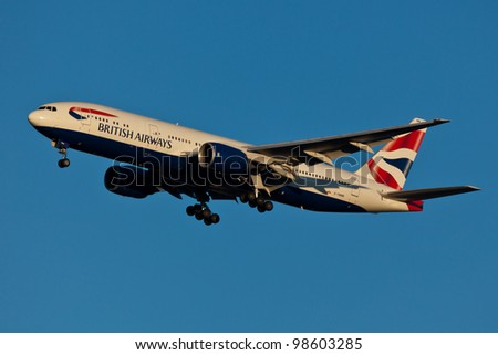 NEW YORK - MARCH 20: Boeing 777 British Airways climbs after take off from JFK in New York, USA on March 20, 2012. British Airways is one of the oldest airlines and rated top 3 biggest in Europe - stock photo