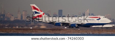 NEW YORK - MARCH 2: Boeing 747 British Airways with Manhattan in background lining up on JFK in New York, on March 2, 2011 British Airways is one of the biggest company in the world and top3 in Europe - stock photo