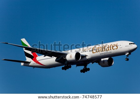 NEW YORK - MARCH 7: Boeing 777 Emirats on final approach to JFK airport located in New York, March 7, 2010. Emirates is rated as a top 10 best airline in the world flying on youngest fleet - stock photo