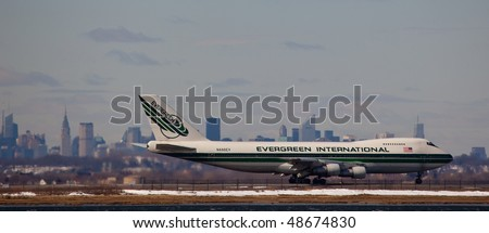 NEW YORK -MARCH 1: Boeing 747 Evergreen arriving on JFK Airport on Runaway 4L with Manhattan skyline in background on March 1, 2010 in New York. Picture taken from Bayswater Park