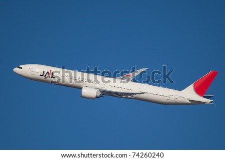 NEW YORK - MARCH 12: Boeing 777 of JAL Japan climb after take of from JFK in New York, USA, on March 20, 2011. Boeing 777 as of 2011 is the newest model build by Boeing and is used by over 50 airlines