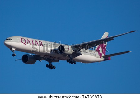NEW YORK - MARCH 5:Boeing 777 Qatar on final approach to JFK in New York, USA on March 5, 2011 Qatar Airline is rated as top3 best airlines in the world. Qatar airline is flag carrier airline of Qatar - stock photo