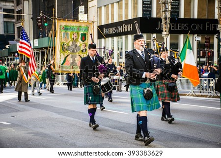 NEW YORK-MARCH 17- Marchers with bagpipes dressed in kilts march in the St Patrick's Day Parade on on 5th Ave in New York City. - stock photo