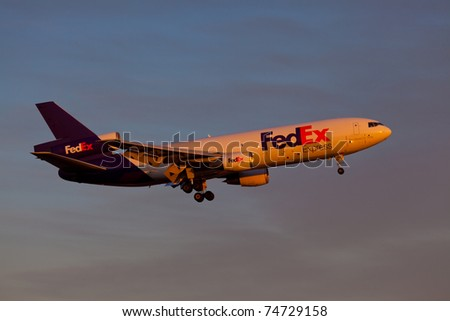 NEW YORK - MARCH 8:MD-10 approaching JFK Airport located in New York, USA on March 8, 2011. Fedex is the biggest shipping/cargo company in the world serve over 300 destinations worldwide - stock photo