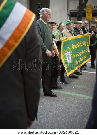 NEW YORK - MARCH 17, 2016: Members of the Emerald Society Police Department City of New York march up 5th Avenue by St Patricks Cathedral during the parade on Saint Patricks Day on March 17, 2016. - stock photo