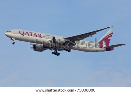 """NEW YORK - MARCH 6: Qatar Boeing 767 on final to JFK in New York, USA on March 6, 2011. Qatart is rated top 3 best airlines in the world. Is also rated the as a """"best food in flight"""" in the world - stock photo"""