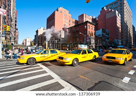 NEW YORK - MARCH 21: Taxicabs between the 7th Av. and 23th st. Licensed by the New York City Taxi and Limousine Commission, there are over 40.000 vehicles. on March 21, 2011 in New York City. USA. - stock photo