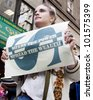 NEW YORK - MAY 1: A protester holds a sign that reads 'Share The Power Spread The Wealth ' during the march to Union Square at Occupy Wall St 'May Day' protests on May 1, 2012 in New York, NY. - stock photo
