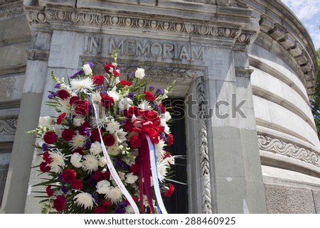 NEW YORK - MAY 25 2015: A wreath under the words In Memoriam carved in the white marble of the Soldiers and Sailors Monument after the Memorial Day Observance service during Fleet Week NY 2015. - stock photo