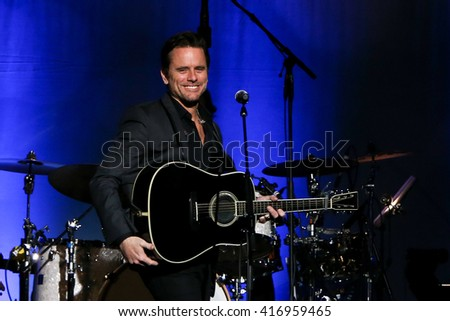 """NEW YORK-MAY 5: Actor/singer Charles Esten performs onstage during ABC's """"Nashville"""" US Tour at the Theater at Madison Square Garden on May 5, 2016 in New York City. - stock photo"""