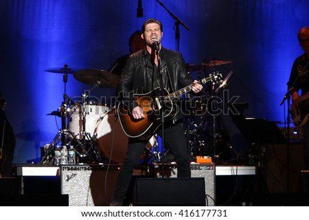 "NEW YORK-MAY 5: Actor/singer Chris Carmack performs onstage during ABC's ""Nashville"" US Tour at the Theater at Madison Square Garden on May 5, 2016 in New York  City."