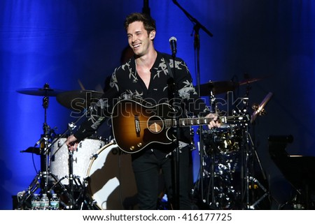 "NEW YORK-MAY 5: Actor/singer Sam Palladio performs onstage during ABC's ""Nashville"" US Tour at the Theater at Madison Square Garden on May 5, 2016 in New York  City."