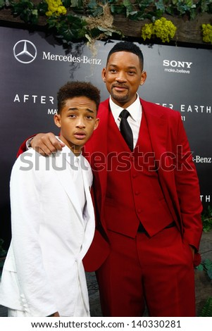 """NEW YORK - MAY 29: Actor Will Smith (R) and son Jaden attend the premiere of """"After Earth"""" at the Ziegfeld Theatre on May 29, 2013 in New York City.  - stock photo"""