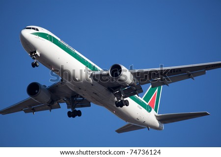 NEW YORK - MAY 20: AlItalia Boeing 767 on final approach to JFK airport located ion New York, USA on May 20, 2010 AlItalia is a flag carrier airline of Italy and one of the biggest airlines in Europe