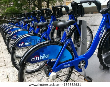 NEW YORK - MAY 24: Bicycles are shown docked at a Citibike sharing kiosk at Bowling Green Station on May 24, 2013 in New York. Operated by NYC Bike Share, thousands of bikes will be available. - stock photo