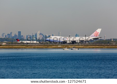 NEW YORK - MAY 8:Boeing 747 China Airlines and Delta regional Bombardier taxing at the JFK Airport located in New York USA on May 8 2012 JFK is considered one of the most busy airport in the world - stock photo