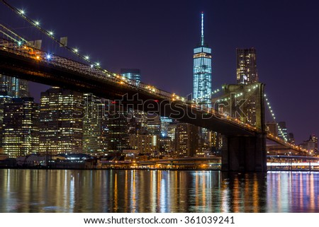 NEW YORK - MAY 3: Brooklyn Bridge and Manhattan skyline at night on May 3, 2015. Brooklyn Bridge connects Manhattan with Brooklyn and is one of the most famous landmarks in New York City. - stock photo
