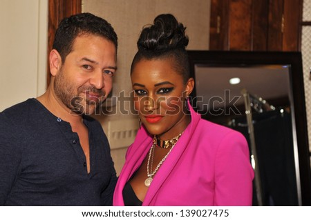 NEW YORK - MAY 16: Designer Alvin Valley (L) and guests at Alvin Valley Fashion Trunk Show & Cocktail Party at 111 East 61st Street, New York, NY  on May 16, 2013 in New York City