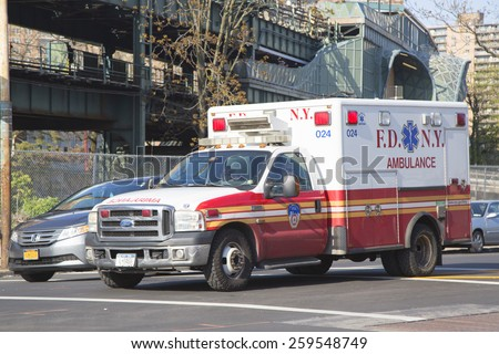 NEW YORK - MAY 17, 2014: FDNY Ambulance in Brooklyn. FDNY is the largest combined Fire and EMS provider in the world  - stock photo