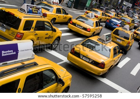 NEW YORK - MAY 28: Group of yellow taxi cabs rush tourists around Manhattan May 28, 2010 in New York City, NY - stock photo