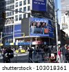 NEW YORK - MAY 18: Image of Facebook CEO Mark Zukerberg is flashed on a screen outside the Thomson Reuters building at the opening bell in Times Square on May 18, 2012 in New York City. - stock photo