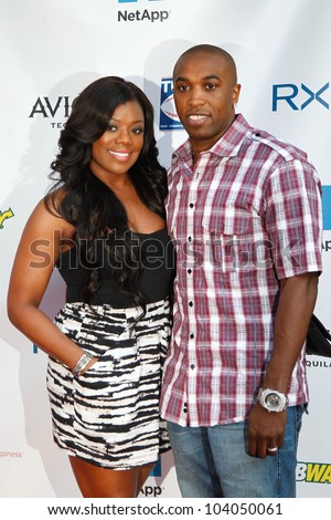 "NEW YORK-MAY 31: Meeka and former NBA player Craig ""Speedy"" Claxton attend the 4th annual Tuck�s Celebrity Billiards Tournament on May 31, 2012 in New York City. - stock photo"