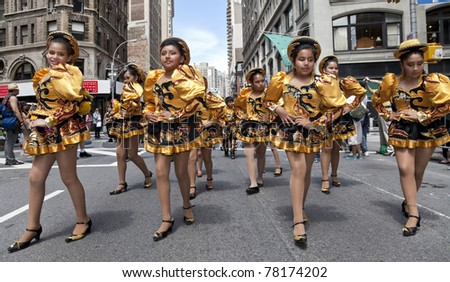 NEW YORK - MAY 21: Members of San Simon group dances on Broadway as part of New York Dance Parade on May 21, 2011 in New York City