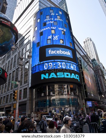 NEW YORK - MAY 18: Message signed by Facebook CEO Mark Zukerberg is flashed on a screen outside the NASDAQ stock exchange at the opening bell in Times Square on May 18, 2012 in New York City. - stock photo