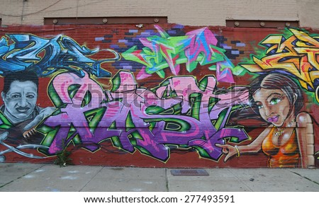 NEW YORK - MAY 12, 2015: Mural art at JMZ Walls in Brooklyn. A mural is any piece of artwork painted or applied directly on a wall, ceiling or other large permanent surface
