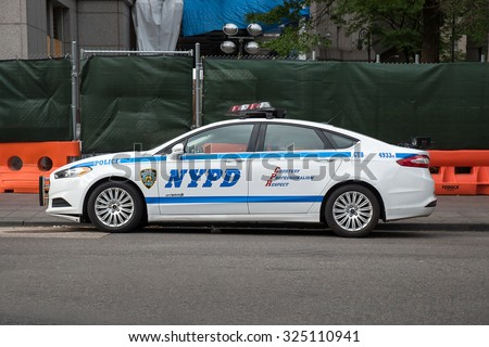 NEW YORK - MAY 20, 2015: NYPD Police car in Manhattan. The New York City Police Department, established in 1845, is the largest municipal police force in the United States.  - stock photo