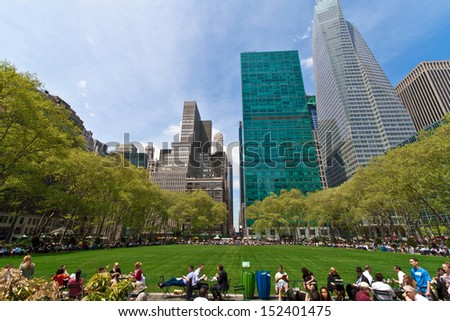 NEW YORK - MAY 7: People enjoying a nice day in Bryant Park on May 7th, 2013 in New York City, NY. Bryant Park is a 9,603 acre park in the center of Manhattan just behind the Public Library.