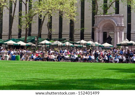 NEW YORK - MAY 7: People enjoying a nice day in Bryant Park on May 7th, 2013 in New York City, NY. Bryant Park is a 9,603 acre park in the center of Manhattan just behind the Public Library. - stock photo