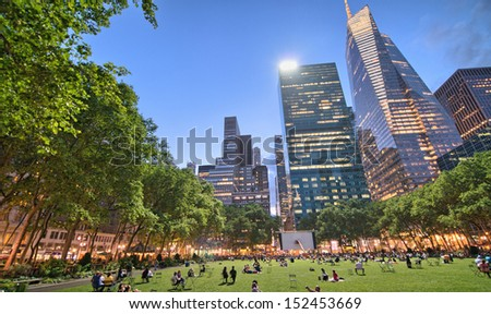NEW YORK - MAY 17: People enjoying a nice evening in Bryant Park on May 17, 2013 in New York City, NY. Bryant Park is a 9,603 acre privately managed park in the center of Manhattan - stock photo