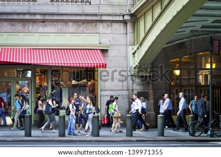 NEW YORK - MAY 21: People walk by Grand Central Terminal in Manhattan in the afternoon rush hour on May 21 2013 in Manhattan. Grand Central Terminal is the busiest train station in the United States. - stock photo