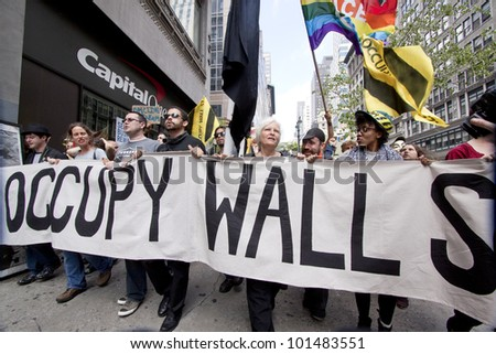 NEW YORK - MAY 1: Protesters march past a Capital One bank on their way to Union Square from Bryant Park during Occupy Wall St 'May Day' protests on May 1, 2012 in New York, NY. - stock photo