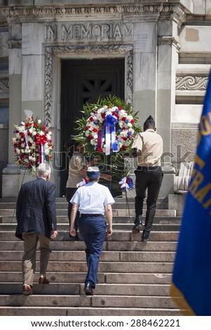 NEW YORK - MAY 25 2015: Rear Admiral Linda Fagan, First Coast Guard District, walks to lay a wreath at the Memorial Day Observance service at the Soldiers and Sailors Monument during Fleet Week 2015. - stock photo