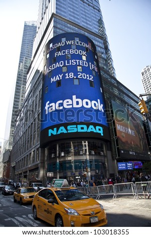 NEW YORK - MAY 18: Sign announcing Facebook IPO is flashed on a screen outside the NASDAQ stock exchange at the opening bell in Times Square on May 18, 2012 in New York City. - stock photo