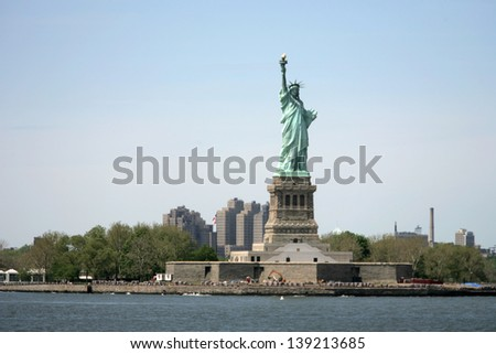 NEW YORK - MAY 17: The Statue of Liberty is shown on May 17, 2013 in New York. The Statue of Liberty was dedicated on October 28, 1886 and restored for her centennial on July 4, 1986. - stock photo