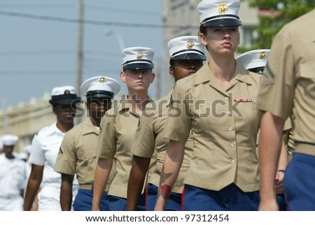NEW YORK - MAY 29:  U.S. military personnel march in the Little Neck/Douglaston Memorial Day Parade May 29, 2006 in Queens, NY. - stock photo