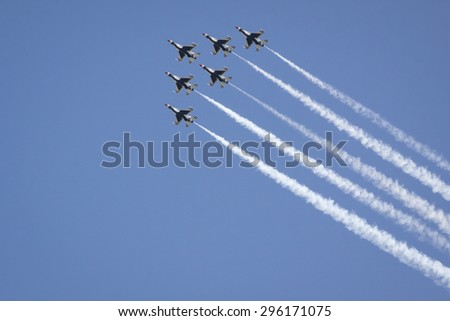 NEW YORK - MAY 22 2015: US Air Force Thunderbird F-16 jets fly above Manhattan in a diamond formation with precision during Fleet Week NY 2015 as part of the Memorial Day celebrations. - stock photo
