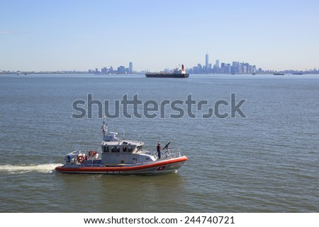 NEW YORK - MAY 25, 2014:  US Coast Guard boat providing security Fleet Week 2014 in New York Harbor - stock photo