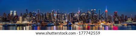 New York midtown panorama at dusk. The Empire State Building displays the colors of the American flag, in honor of the Presidents' Day (91Mpx) - stock photo