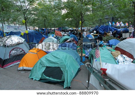 NEW YORK, N.Y. - OCTOBER 31 - Occupy Wall Street protesters' tent city at Zuccotti Park in the financial district, October 31, 2011, New York. - stock photo
