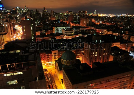 NEW YORK, NEW YORK - APRIL 4, 2009: New York's East Village Skyline at Night view views of the Ukrainian Orthodox Church. - stock photo