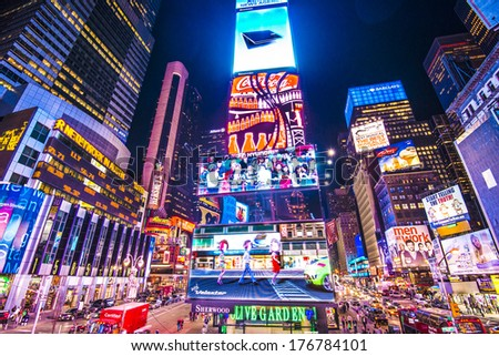 NEW YORK, NEW YORK - APRIL 9, 2013: Times Square lights at night in Midtown Manhattan. The site is regarded as the world's most visited tourist attraction with nearly 40 million visitors annually. - stock photo